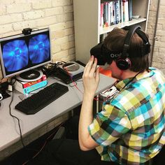 An awesome Virtual Reality pic! Students trying out the Oculus Rift VR headset today in the office. Flying through time with doctor who.  #virtualreality #vr #oculus #oculusrift #virtual #reality #startup #tech #technology #innovation #doctorwho by bitspacedevelopment check us out: http://bit.ly/1KyLetq