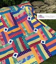 """Corner Kick uses riotous colors and patterns to boot your modern quilting into another bracket. The crisp corner ""kicks"" provide a resting place for Jellyroll Quilts, Lap Quilts, Scrappy Quilts, Mini Quilts, Quilt Blocks, Crib Quilts, Jelly Roll Quilt Patterns, Applique Quilt Patterns, Modern Quilt Patterns"