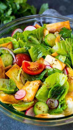 A Mediterranean salad with lettuce vegetables lemon dressing and pita chips. A Mediterranean salad with lettuce vegetables lemon dressing and pita chips. Best Salad Recipes, Salad Dressing Recipes, Vegetarian Recipes, Cooking Recipes, Healthy Recipes, Arugula Salad, Nectarine Salad, Cucumber Tomato Salad, Kitchen