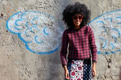 Love the idea of posing in front of butterfly wings chalked on a wall