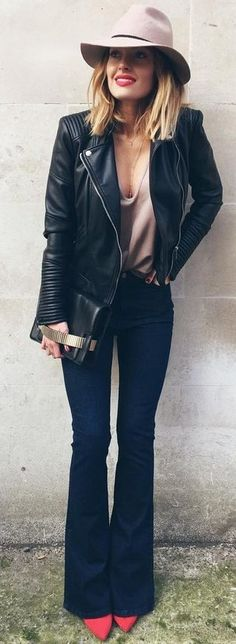 All Black With Pop Of Blush | Caroline Receveur  Hat, black leather jacket, flared jeans