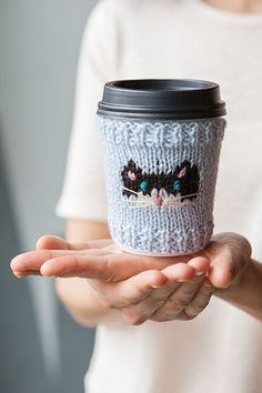 Cat-puccino Cup Cozies - Knitting Patterns and Crochet Patterns from KnitPicks.com by Edited by Knit Picks Staff On Sale Mug Cozy Pattern, Knitting Patterns, Crochet Patterns, Cup Cozies, Knitted Cat, Knit In The Round, Cat Mug, Coffee Cozy, Knit Picks