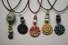 White Clover Kiln Pendants and Beads on naturally dyed leather cords