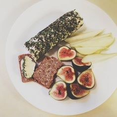 Snack Plate: cultured cashew herbed chèvre cheese roll, figs, pears, and crackers #vegan #artisanvegancheese