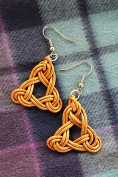 Golden leather triquetra celtic earrings by bexybeads, via Flickr