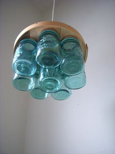 UpCycled ReCycled Flat Top Wood and Blue Mint Pint Sized Ball Glass Mason Jar Chandelier Hanging Pendant Lighting Fixture - Free Shipping. $125.00, via Etsy.
