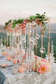 If you find yourself daily dreaming of rom-coms in Italy, then this lavish peach wedding inspiration in the heart of Siena just might stop you in your tracks. With a Tuscan hill view and floating candles along the tablescape, this European vineyard fete i Tall Wedding Centerpieces, Flower Centerpieces, Flower Arrangements, Centerpiece Ideas, Wedding Tables, Coral Wedding Decorations, Centrepieces, Quinceanera Centerpieces, Wedding Arrangements