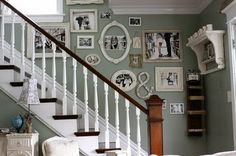 Details in the Decor: Mixing shapes, sizes and mediums immediately creates interest and keeps the eye moving - the placement over the staircase creates an even more interesting display