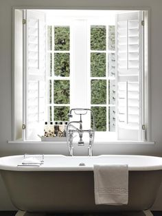 Roll top bath & simple shutters - pared-back style at Babington House