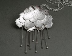 Lisa West - Cloud pendant with falling rain.
