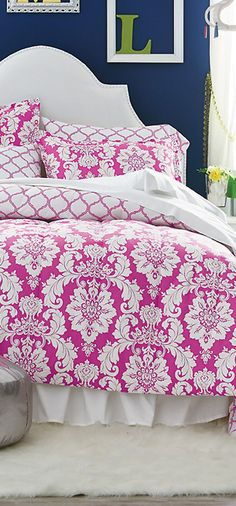 bolder than i'd usually do....but i love the contrast of the blue wall and pink bedspread