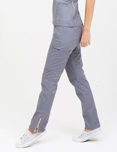 The Moto Pant in Graphite is a contemporary addition to women& medical scrub outfits. Shop Jaanuu for scrubs, lab coats and other medical apparel. Healthcare Uniforms, Medical Uniforms, Scrubs Outfit, Scrubs Uniform, Spa Uniform, Stylish Scrubs, Lab Coats, Moto Pants, Medical Scrubs