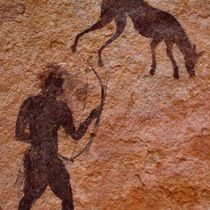 """The Tassili - """"plateau of the rivers"""" in Arabic - is an open-air treasure-trove of more than 15,000 rock carvings and cave paintings that depict pre-historic crocodiles and cattle, giraffes and Giraffes."""