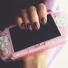 Monarch butterfly nails + PSP in a pink case