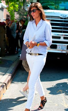 white jeans, blue shirt, black and gold accesories