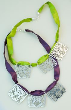 "CRISTINA CELIS ""Papel Picado"" silver and silk necklace"