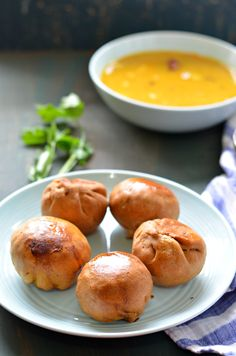 Rajasthani masala baati- Crispy dough balls, stuffed with spicy green peas mix and served with a dollop of Ghee on top. Yummy!