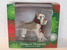 One Sandicast Dog Ornament for Hanging on the Christmas Tree.  Schnauzer UC, Gray Color, Item XSO14104, UPC 746314016190 and wearing a Scarf  Packaging states that the Dog Ornament has been Hand Cast and Hand Painted.