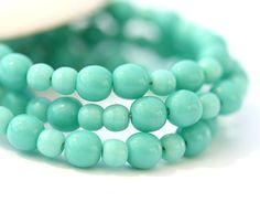 Turquoise green Czech glass beads