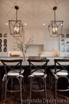 Love the pendant lighting.... White shaker style kitchen, with cross