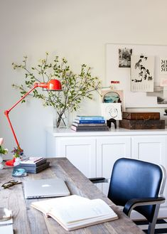 The elm-and-cast-metal desk from Restoration Hardware adds a rustic touch to the otherwise spare, Scandinavian-feeling space.