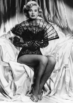 Zsa Zsa Gabor , Hungarian-American actress and socialite, died at 99. Her century of life was filled with couture, diamonds, and nine husbands. She also appeared in more than 60 television movies and feature films and leant her stunning looks to magazines and ad campaigns. Here, a look back at the most fashionable moments in Zsa Zsa Gabor's glamorous life. Follow us on Instagram , Facebook , and Pinterest for nonstop inspiration delivered fresh to your feed, every day.