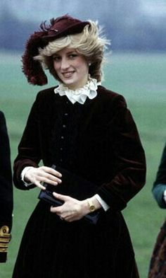 Princess diana...her early style (1983) - classic velvet suit with cream frilly collared blouse and hat with feather.
