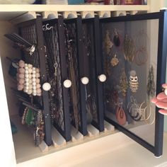 We took some empty cabinet space in my sisters bathroom and created jewelry displays out of picture frames, hooks, fabric, a spool holder, window screen material, drawer pulls and trim (for the guides). Now she can see everything and access it easily. Cute and easy project!