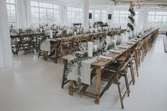 Wooden Trestle Tables For An Industrial Wedding In London - Stylish London Wedding At Asylum and Snap Studios Shoreditch With Bride In Stephanie Allin And Images From Marshal Gray Photography