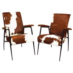 Pair of rod iron Armchairs by Pierre Guariche in cowhide ca.1950