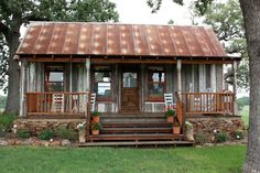 Love this rustic tin house!