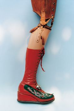 Frida Kahlo's prosthetic leg, which she outfitted herself with a red leather, Chinese-embroidered boot with bells. Her wardrobe, locked away for 50 years, is now the subject of a new exhibition. | Dangerous Minds