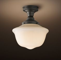 RH's Parisian Architectural Milk Glass Ecole Flushmount:Inspired by the City of Light, our replicas of vintage Parisian architectural fixtures highlight their functional, serviceable beauty. We've reproduced these lights unchanged, shaping them of white glass with a soft translucence.
