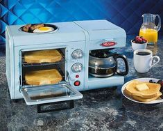Nostalgia Electrics' charming Breakfast Station is great for making quick meals. It has a mini toaster oven, coffeemaker and a built-in grill Coffee Station Kitchen, Home Coffee Stations, Cool Kitchen Appliances, Cool Kitchens, Modern Toasters, Mini Toaster, Built In Coffee Maker, Breakfast Station, Rotisserie Oven