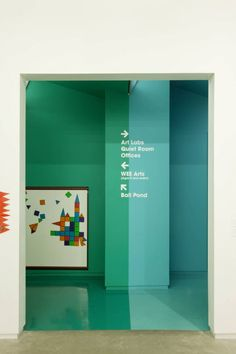 Directional wall sign at Children's Museum of the Arts by Work Architecture Company