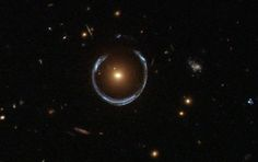 "LRG 3-757. It looks like a Christmas bauble, but it's an Einstein ring. This is created when the gravity of a massive galaxy distorts the light from a more distant one. It's acting like a gravitational lens & in this case, the images of the distant blue galaxy almost complete a circle Einstein predicted the effect long before it was ever seen. (Image Credit: ESA/Hubble & NASA) Mona Evans, ""Cosmic White Christmas"" http://www.bellaonline.com/articles/art300463.asp"