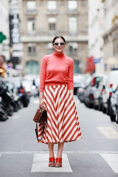The full skirt silhouette is very retro, so play this up when styling your skirts this season. This outfit was photographed by Victoria Adamson for Refinery 29. The chevron striped skirt is a statement maker and looks chic teamed with a matching coloured sweater, cat eye sunglasses, and structured handbag. Try recreating this outfit with a patterned skirt for a similarly stylish look.