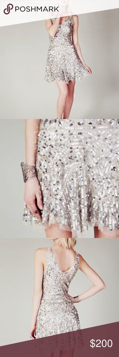 Free People | Sequin Shimmy Shimmy Dress Vintage-inspired sequin-covered party dress from Free People. features drop waist styling, flared skirt, v-back and neckline, hidden side zipper and ties at shoulders. 100% Nylon 100% Viscose lined View Size Chart Free People Dresses