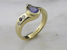 14 K Yellow Gold ring with .4ct Sapphire and Diamond accent