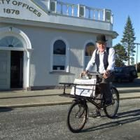 Sam Inder steps back in time to deliver copies of the Otago Daily Times around Naseby to those taking part in the Inder family reunion