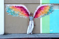 Wearing the infamous Victorias Secret wings without the fuss and most importantly without the diet? In WeHo, it's possible. I guess everything's is possible here. The genius that Colette Miller is (see my first wings here), she adorned this already adorned place with a set of rainbow wings so that everyone can become a gay …