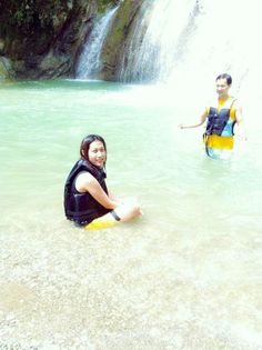 Enjoying the cold crystal-clear water of Danasan Falls