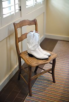 White Lucchese cowboy boots. Photo by Harrison Studio.