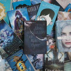 Sea of books  -- Day 19 of #dawntoduskjune \\ literally made my sea blue featuring the beautiful Mara Dyer cover!! #bookchallenge #bookstagram #theevolutionofmaradyer #seaofbooks