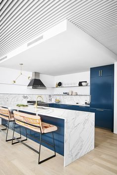 """Kitchen Floating Steel Shelves and metal inlay on surrounding walls - Robert wanted a minimal kitchen. We passed on upper cabinets and opted for sleek floating metal shelves that wrapped around the walls with a 1/4"""" metal inlay on the surrounding walls. The metal perfectly complimented the already industrial feel of the unit."""