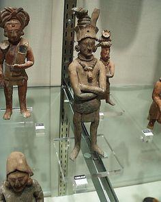 Mayan ceramic figures on display at the Denver Art Museum.