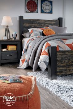 Create your own statement-making style with the Westinton Full Poster Bed! Featuring orange and gray accessories, athletic-inspired wall art and a neutral lamp and rug to pull together the perfect look! iKidz Rooms® - Kids bedroom furniture and ideas - Teen and Youth bedroom inspiration - Ashley Furniture - #AshleyFurniture