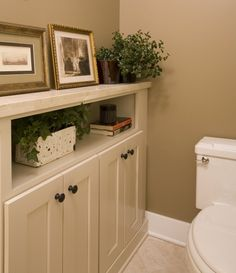 Perfect idea for the separate water closet in the master bathroom: Cabinet to hold toiletries and feminine products plus a shelf for books, etc. Add an outlet inside the shelf for charging phone, iPad, etc.