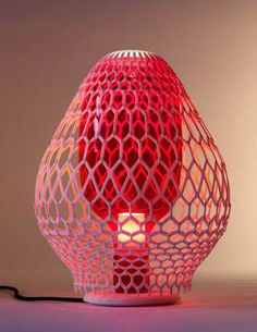 Exnovo is an Italian brand that creates lighting and jewelry through 3-D printing technology. Its new Rhizaria design, displayed in table an...