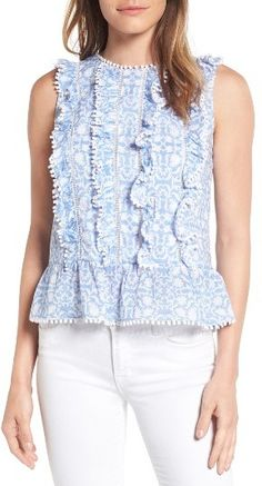 Love this sweet blouse with white jeans.